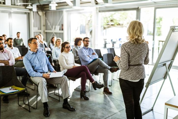 Business woman leading training class
